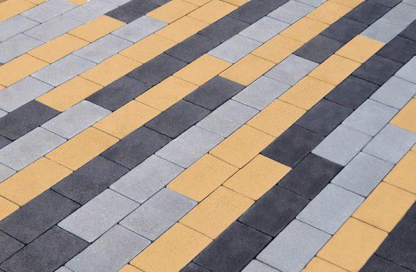 Приклад чорної, сірої та жовтої тротуарної плитки. Купити у салоні тротуарної плитки «Melius» у Вінниці
